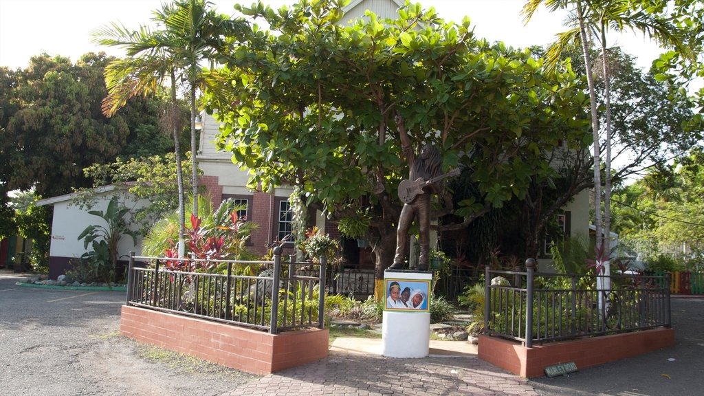 Bob Marley Museum featuring a statue or sculpture and a house