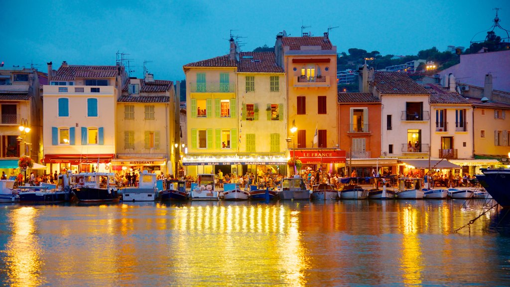 Cassis showing night scenes, a coastal town and a bay or harbor