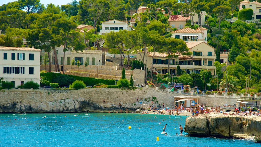 Cassis which includes rugged coastline, a coastal town and a beach
