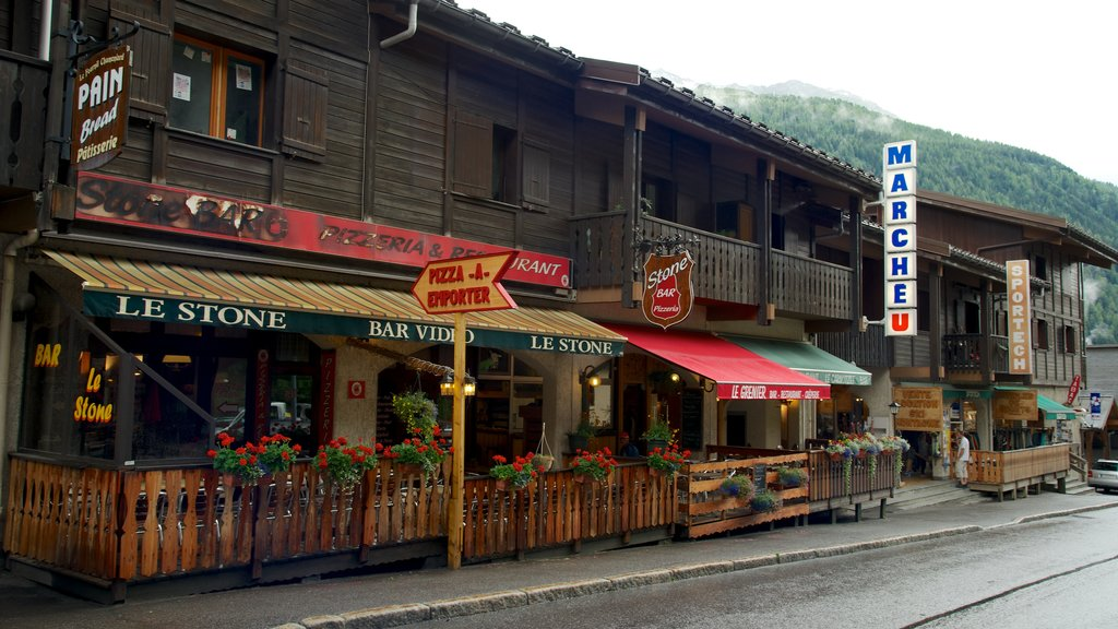 Argentiere which includes street scenes, a bar and signage