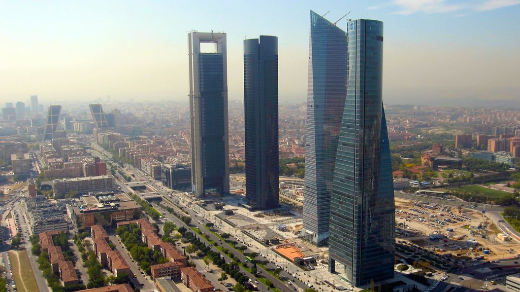 Madrid which includes a high rise building, a city and modern architecture