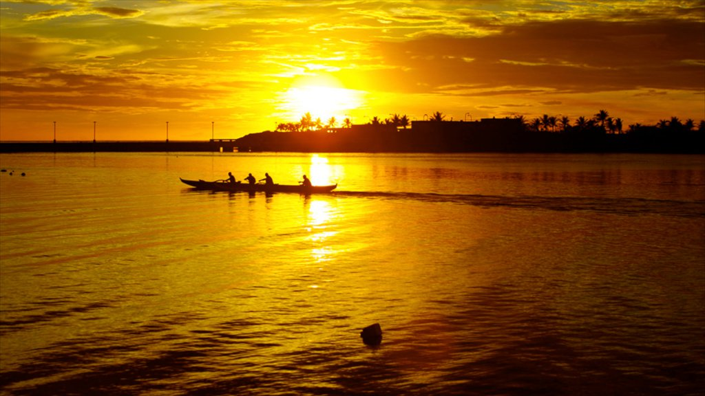 Guam showing general coastal views, a sunset and kayaking or canoeing