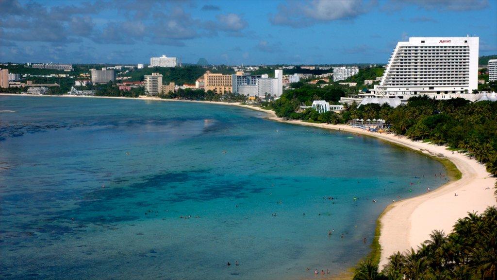 Guam featuring a beach, a coastal town and a bay or harbor