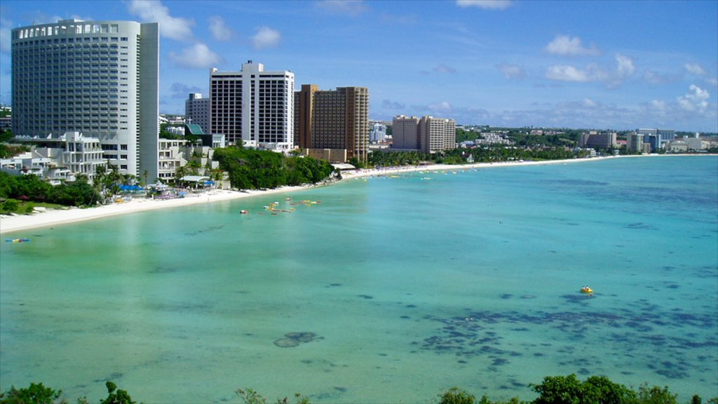 Tumon Beach which includes tropical scenes, a luxury hotel or resort and general coastal views