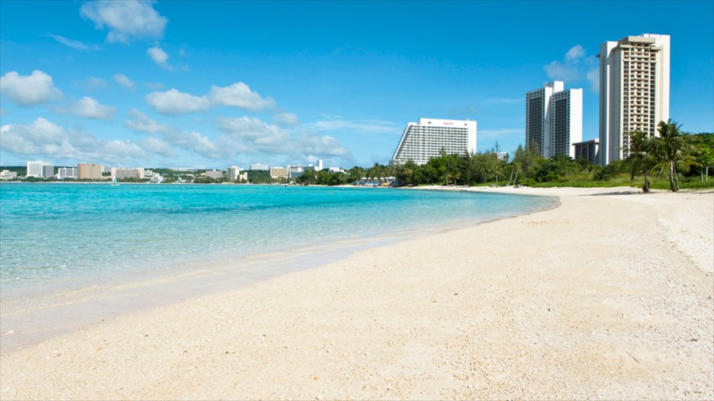 Guam showing a luxury hotel or resort, a sandy beach and tropical scenes