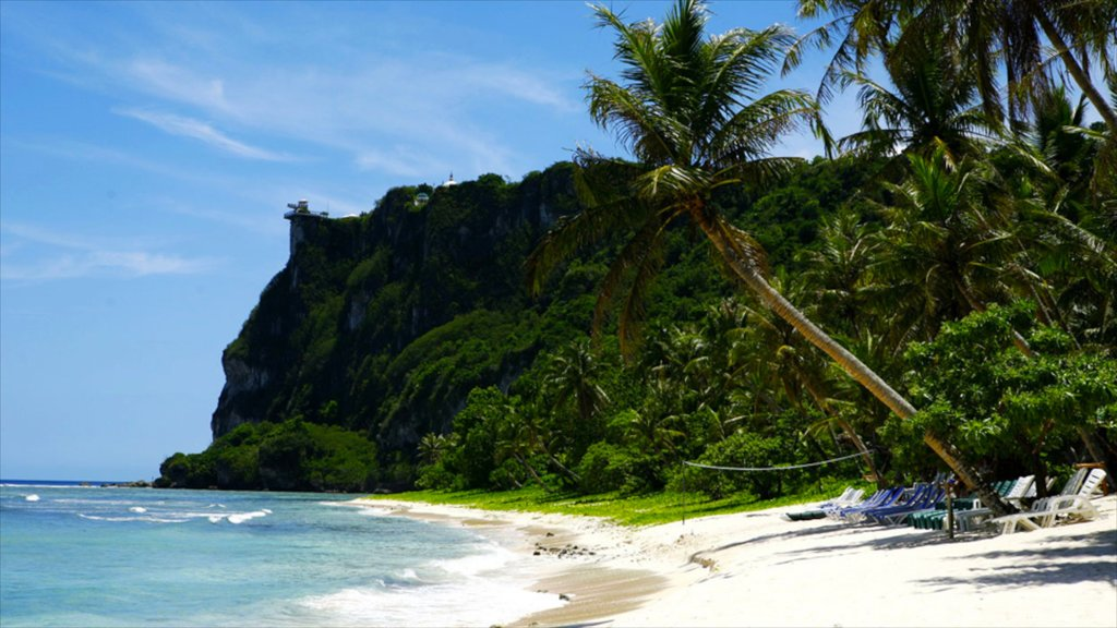 Tumon Beach showing a gorge or canyon, tropical scenes and a sandy beach