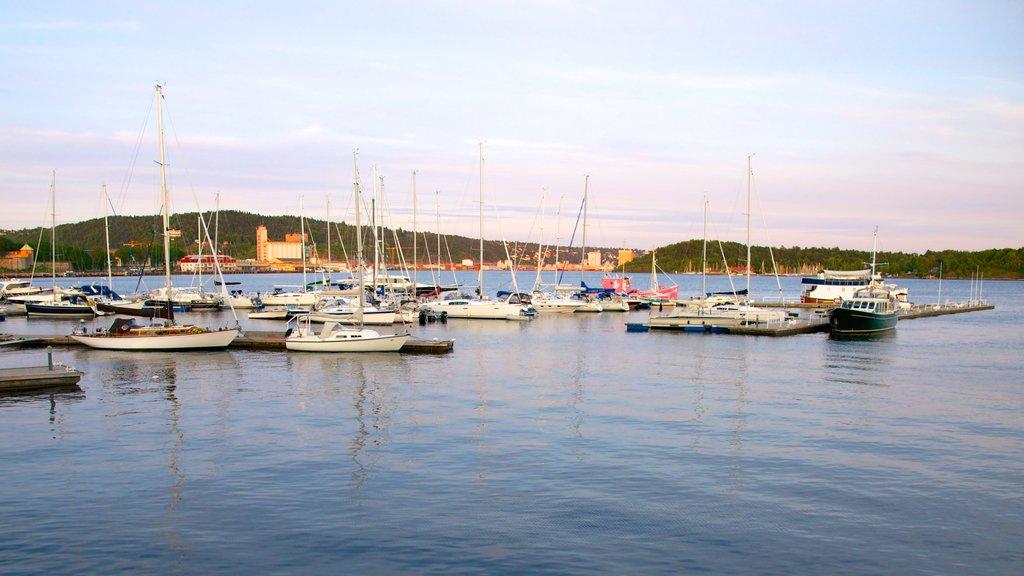Aker Brygge showing general coastal views, a bay or harbor and sailing