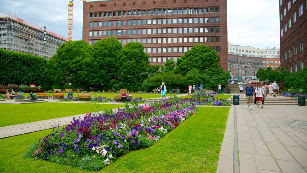Oslo City Hall featuring a garden, an administrative buidling and flowers