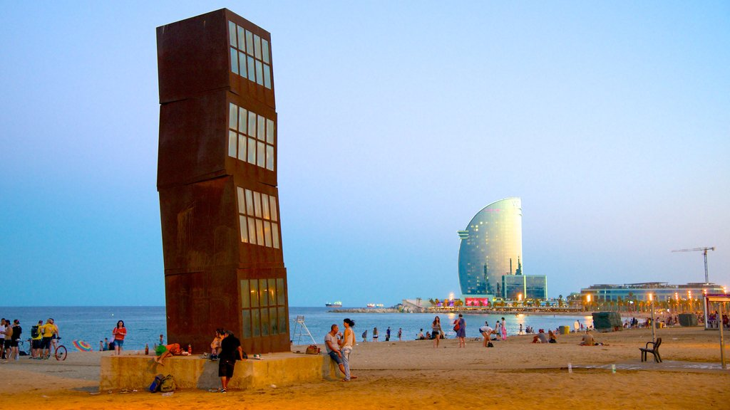 Barceloneta Beach which includes outdoor art, a beach and modern architecture
