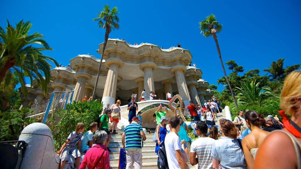 Barcelona which includes a garden and heritage architecture as well as a large group of people