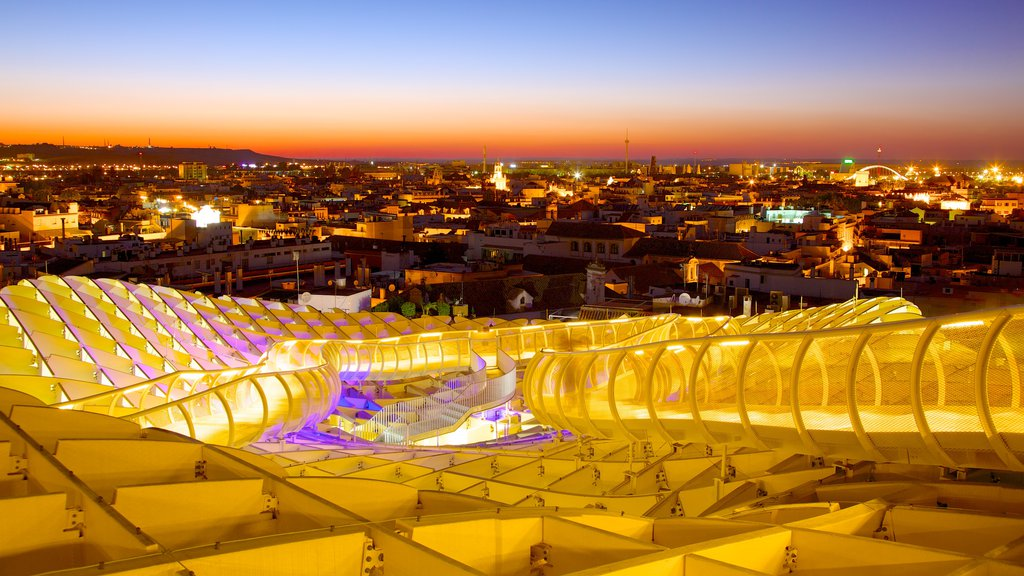 Metropol Parasol featuring a city, a sunset and modern architecture