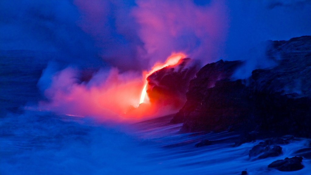Pahoa which includes rocky coastline, night scenes and mist or fog