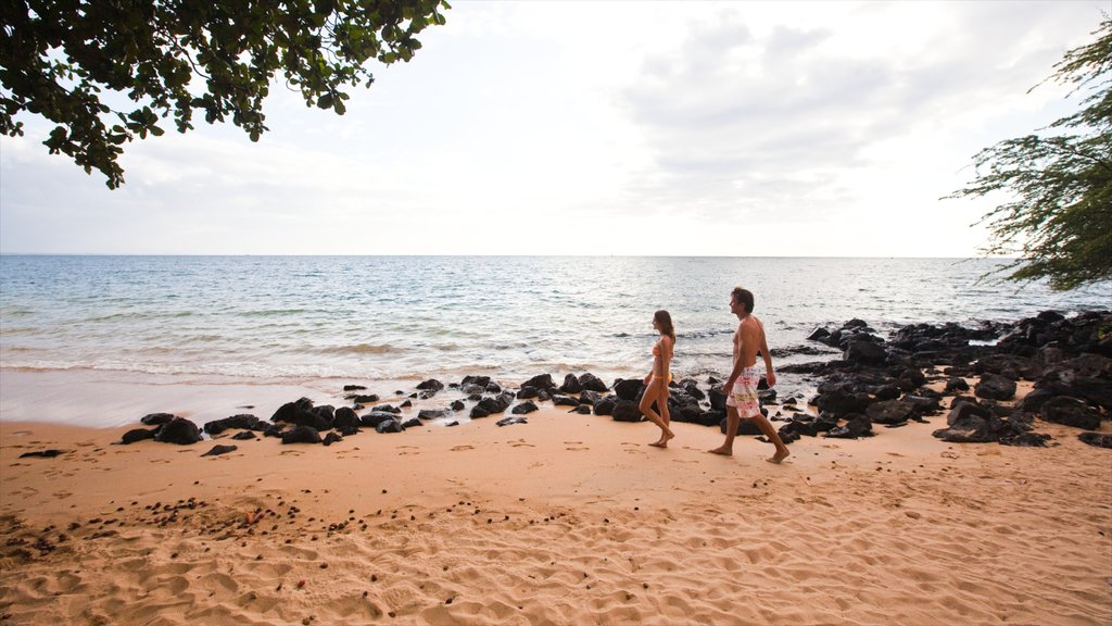 Kawaihae which includes a beach and rocky coastline as well as a couple