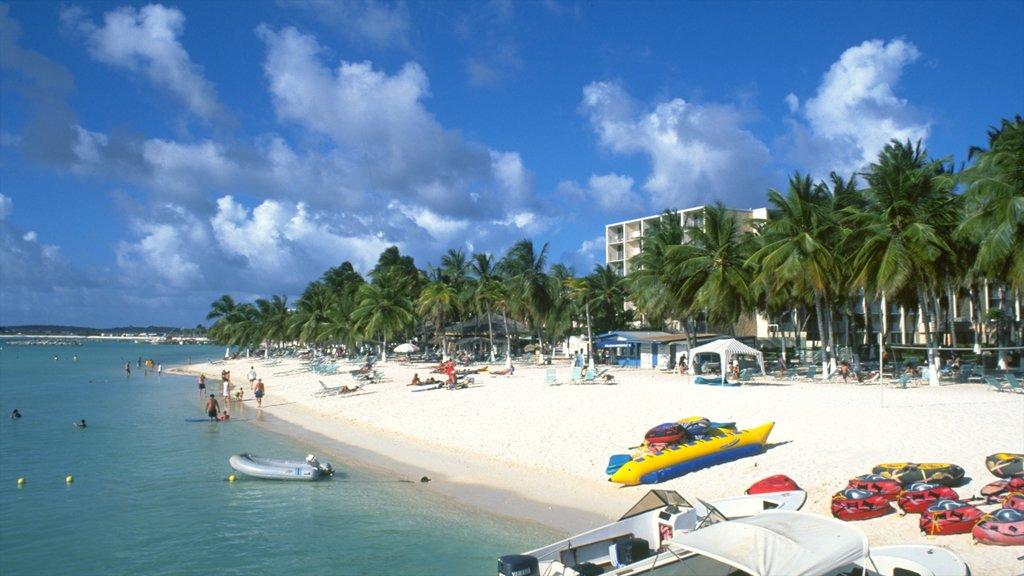 Aruba showing tropical scenes, a coastal town and a beach