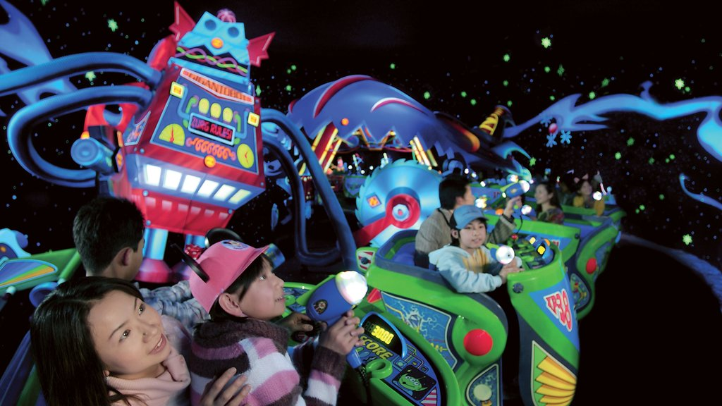 Disneyland® Tokyo showing rides as well as a family
