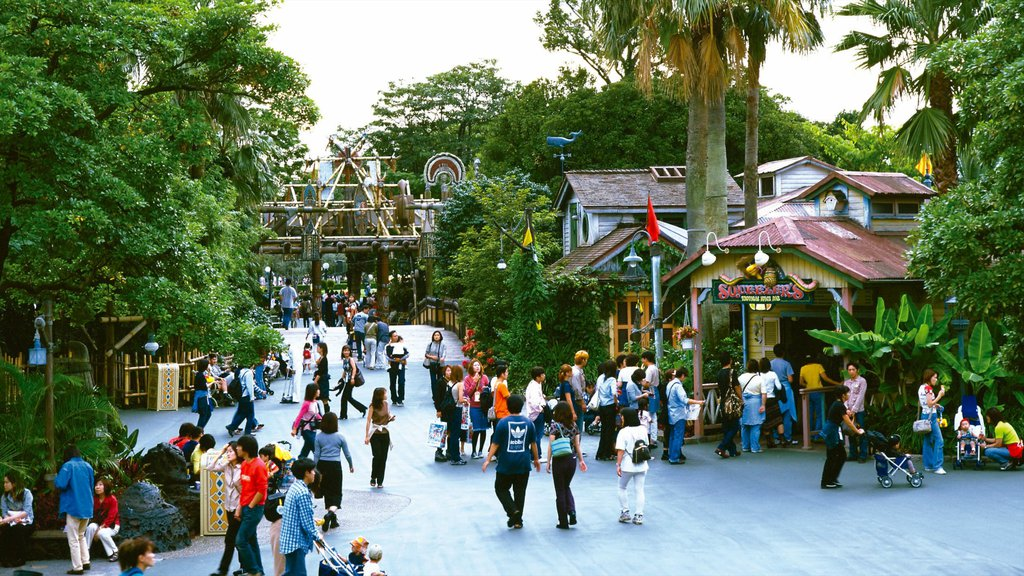 Disneyland® Tokyo featuring rides as well as a large group of people