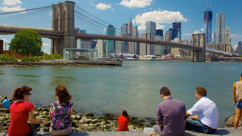 Brooklyn Bridge showing a bridge, a river or creek and a city
