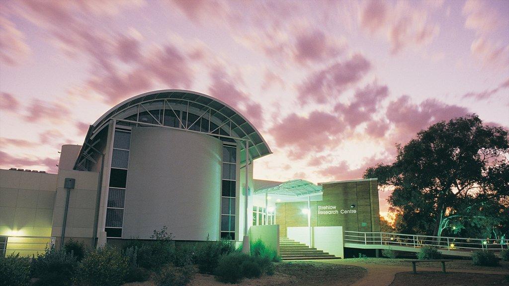 Araluen Cultural Precinct featuring modern architecture, aircraft and a sunset
