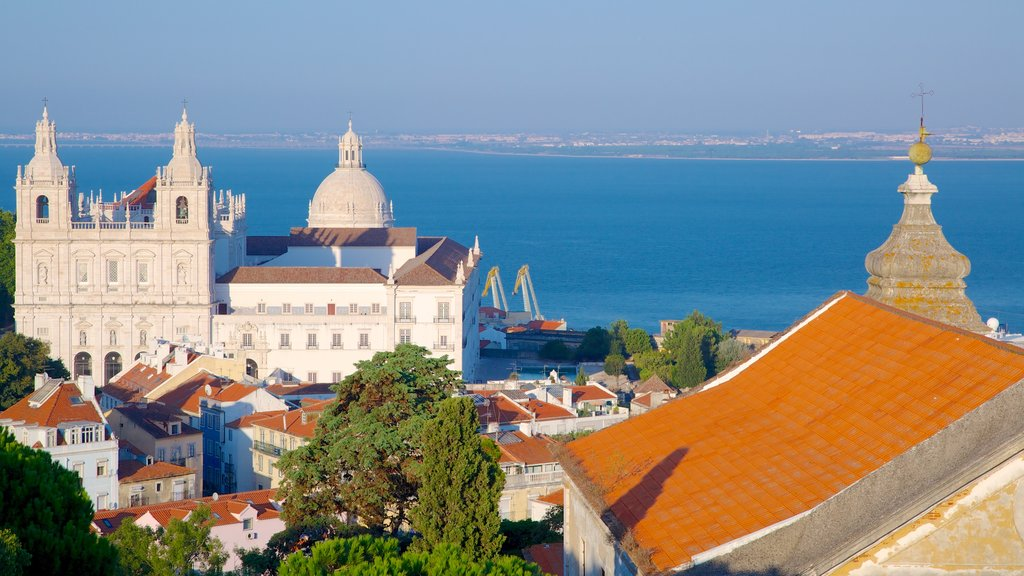 Castle of Sao Jorge which includes heritage architecture, general coastal views and a castle