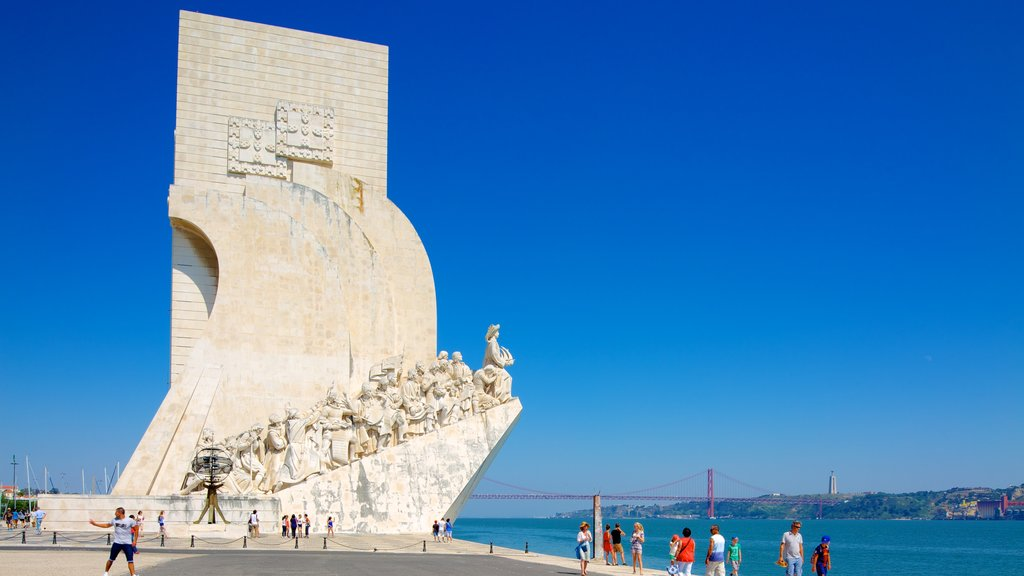 Lisbon featuring outdoor art, general coastal views and a bay or harbor
