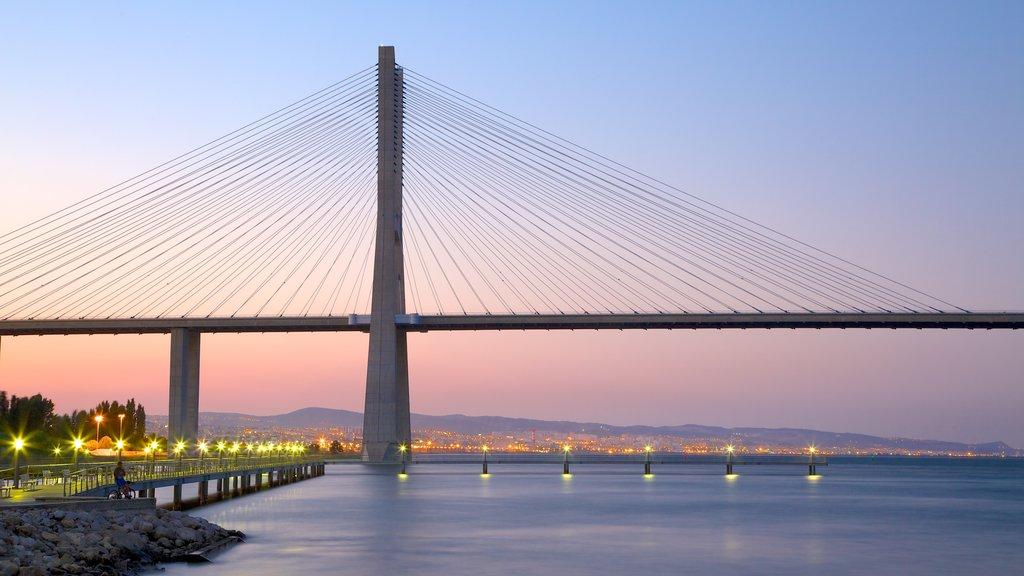 Vasco da Gama Bridge showing modern architecture, a bridge and a sunset