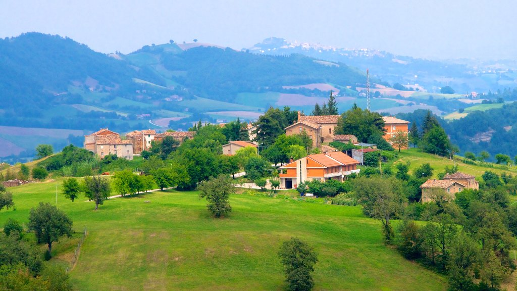 Italy featuring mountains, a small town or village and tranquil scenes