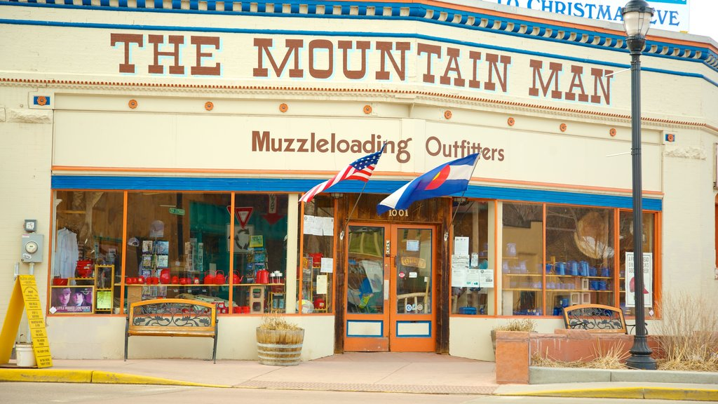 Manitou Springs which includes signage and a small town or village