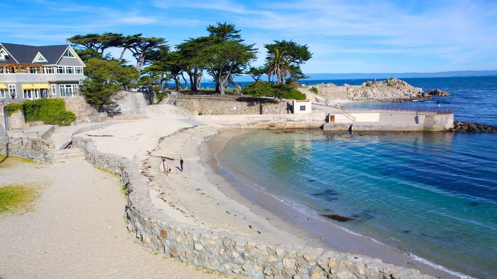 Central California showing a sandy beach, a house and rocky coastline