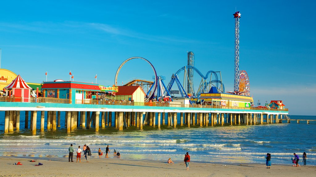 Galveston Island Historic Pleasure Pier featuring rides, a beach and general coastal views