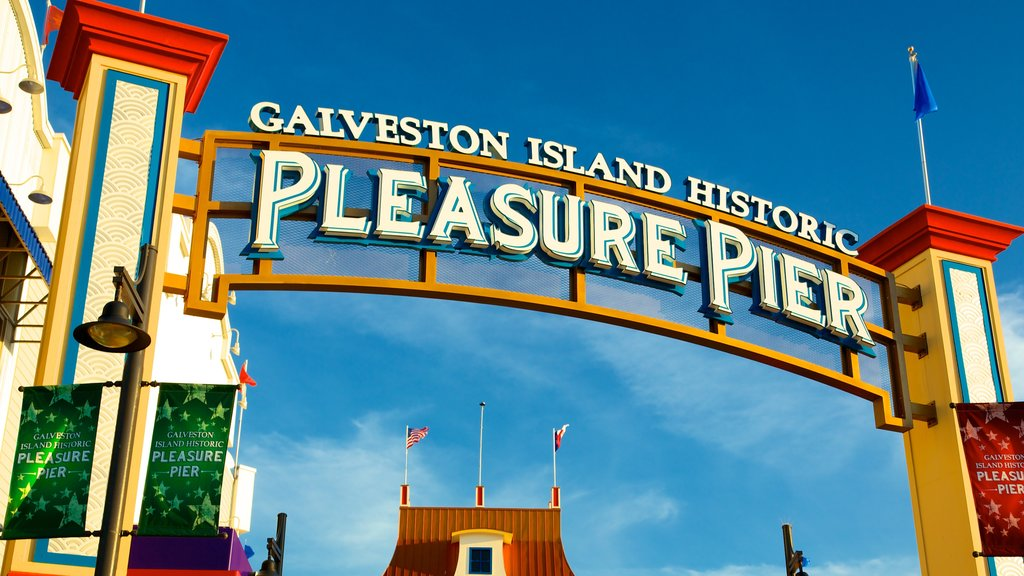 Galveston Island Historic Pleasure Pier showing rides and signage