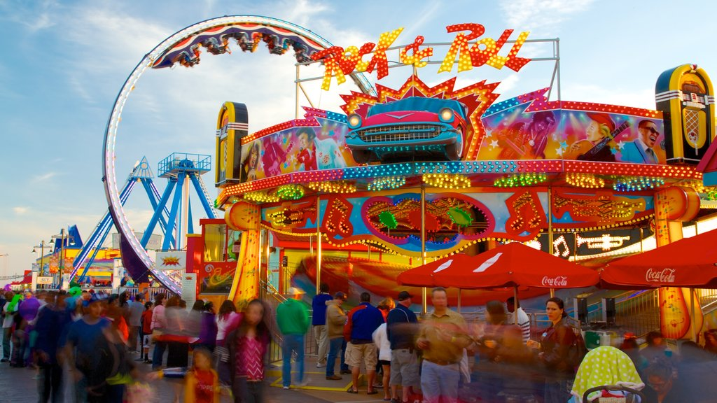 Galveston Island Historic Pleasure Pier which includes rides as well as a large group of people