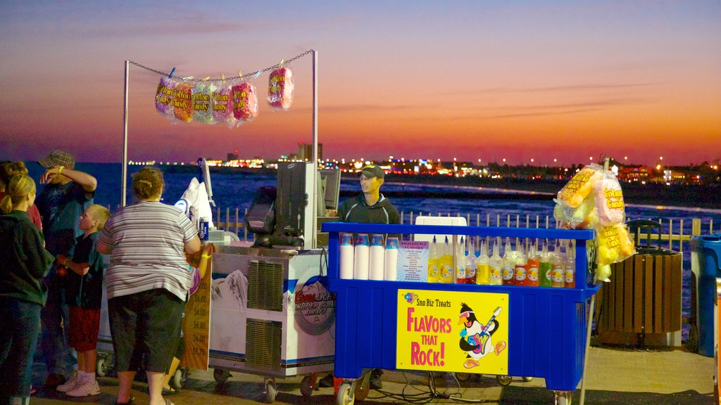 Galveston Island Historic Pleasure Pier featuring signage, outdoor eating and rides