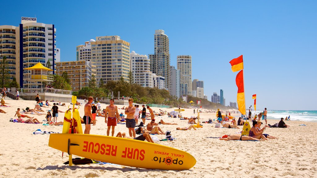 Surfers Paradise Beach showing a coastal town, a skyscraper and a beach