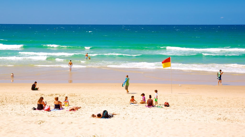 Surfers Paradise which includes a sandy beach, general coastal views and swimming