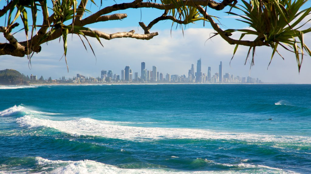 Burleigh Heads featuring waves, a coastal town and a skyscraper