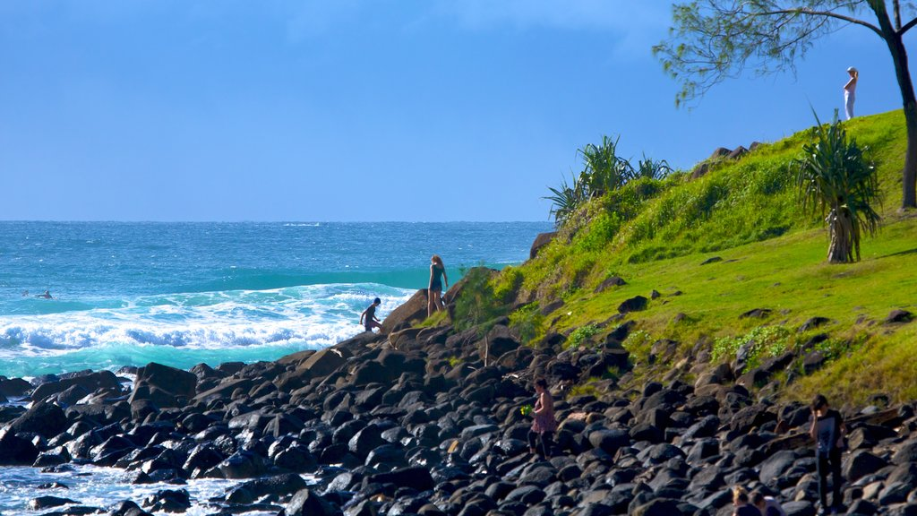 Burleigh Heads featuring rocky coastline