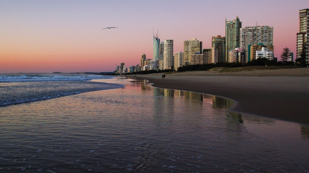 Broadbeach showing a sunset, general coastal views and a beach