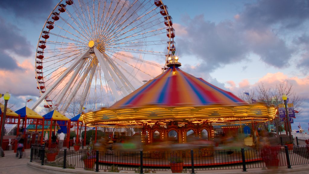 Navy Pier which includes rides and a sunset
