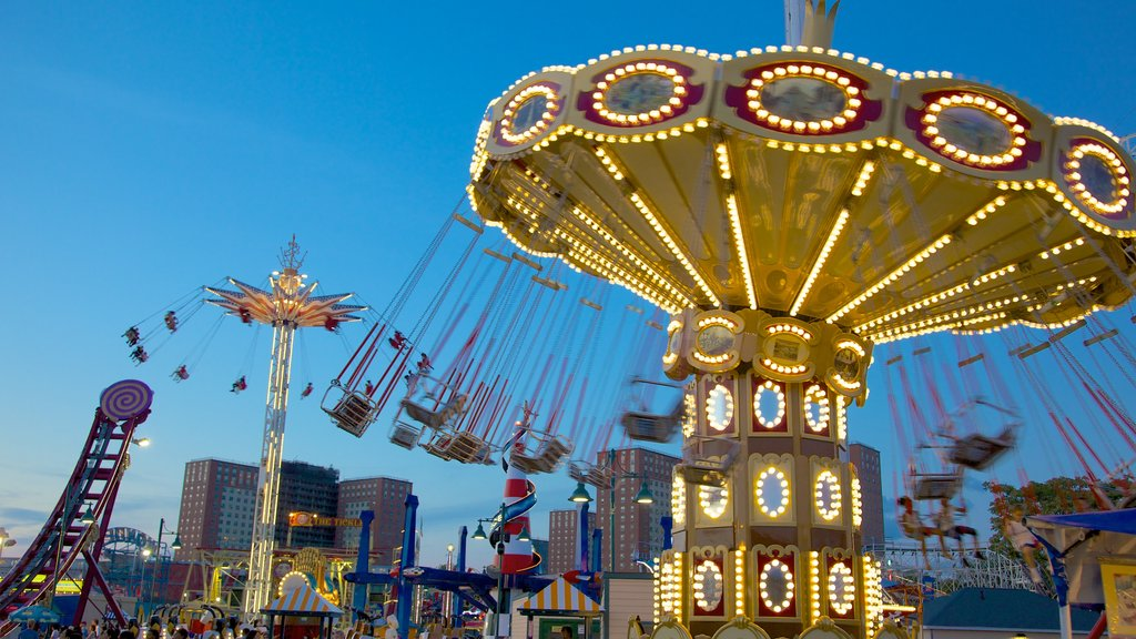 Coney Island featuring rides and night scenes
