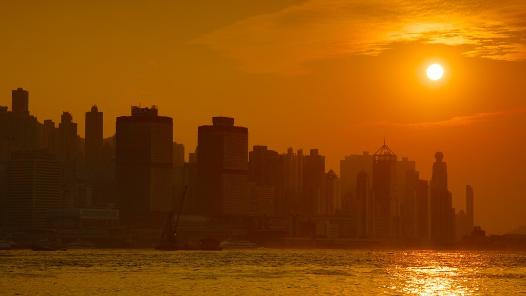Hong Kong showing a high rise building, a city and a sunset