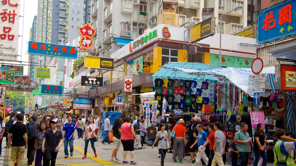 Kowloon which includes markets, signage and a city