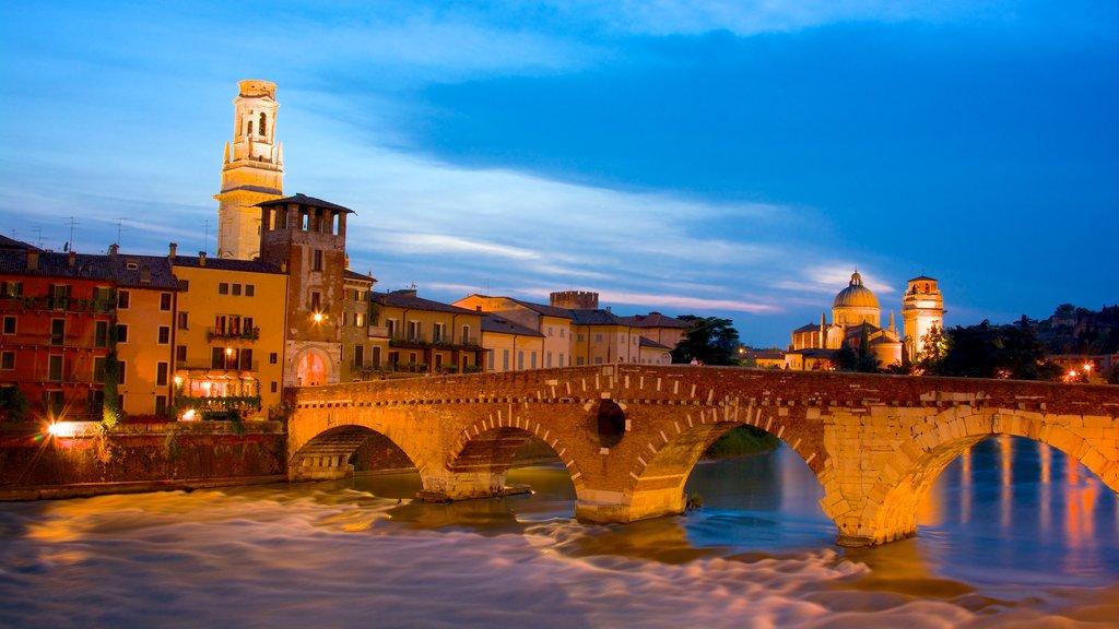 Verona showing night scenes, a bridge and a city