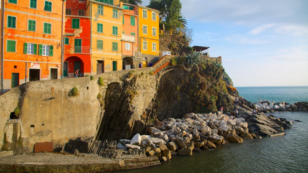 Riomaggiore featuring a coastal town, rugged coastline and a house