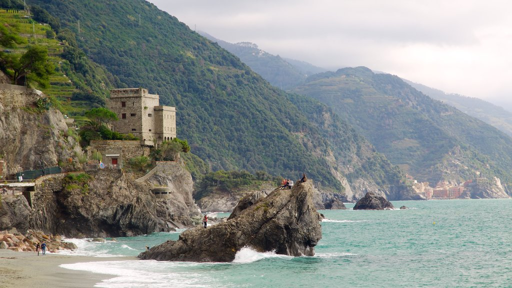 Monterosso al Mare which includes a sandy beach, mountains and rocky coastline