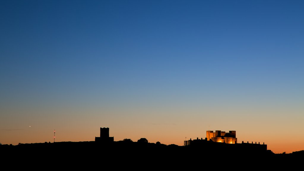 Dover Castle which includes a castle, landscape views and a sunset