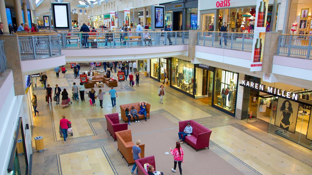 Bluewater Shopping Centre which includes interior views and shopping as well as a large group of people