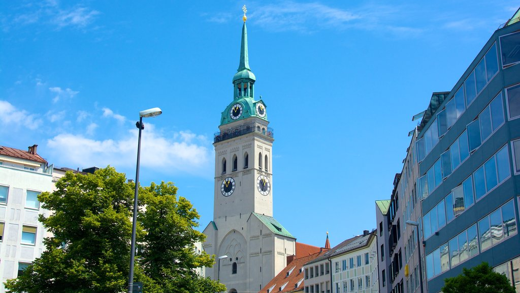 Munich featuring a church or cathedral, religious elements and a city