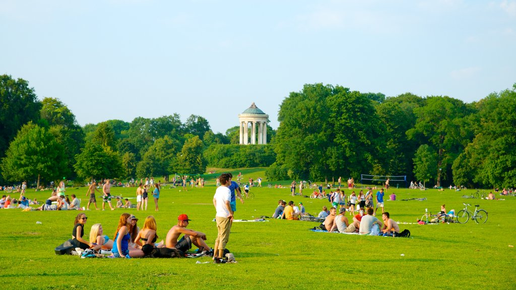 English Garden featuring a city and a garden as well as a large group of people