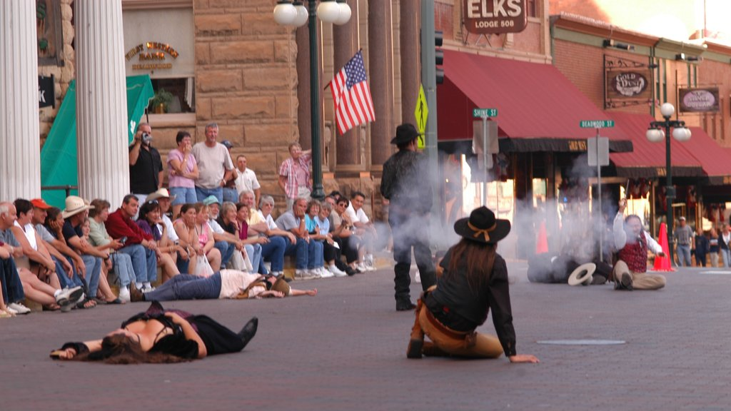 Deadwood showing performance art, street performance and a city