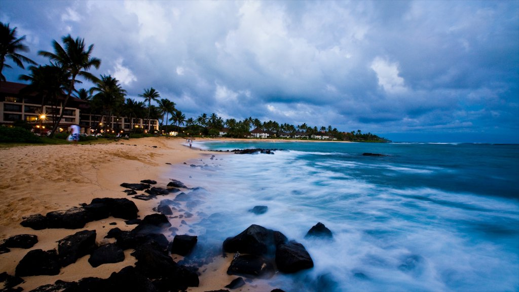 Poipu featuring a sandy beach and tropical scenes